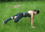 Plank pose in yoga with Tree pose legs